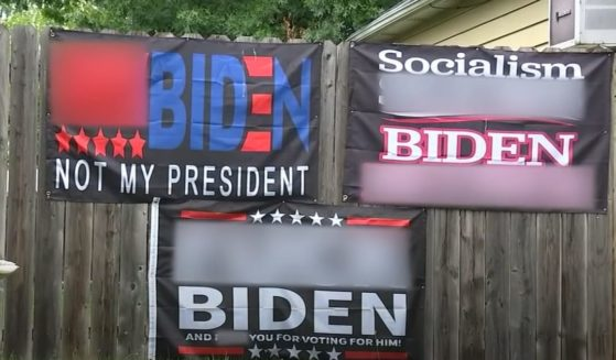 Signs decrying President Joe Biden with vulgar language are displayed at a home in Roselle Park, New Jersey.