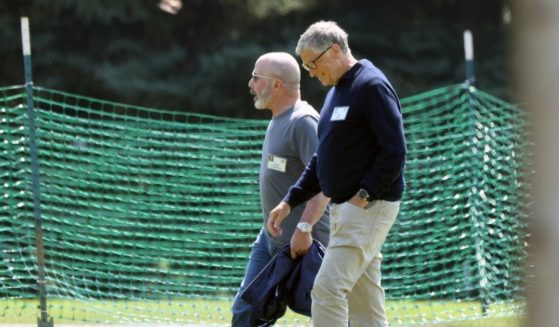 President and CEO of Chubb Limited Evan Greenberg, left, and Co-founder of Microsoft Bill Gates, right, walk together following a session at the Allen & Company Sun Valley Conference on Thursday in Sun Valley, Idaho.