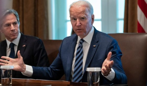 President Joe Biden speaks while Secretary of State Antony Blinken looks on at the start of a Cabinet meeting in the Cabinet Room of the White House in Washington on Tuesday.