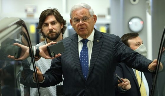 Democratic Sen. Robert Menendez of New Jersey speaks to reporters in the Senate Subway on Capitol Hill on July 20, 2021, in Washington, D.C.