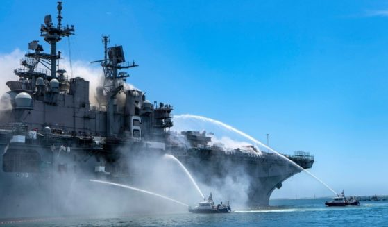 Police boats combat a fire aboard the amphibious assault ship USS Bonhomme Richard at Naval Base San Diego on July 12, 2020.