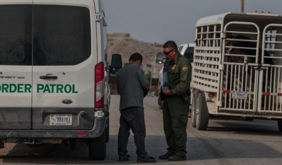 A man from El Salvador is processed by a U.S. Border Patrol agent in Sunland Park, New Mexico on Thursday.