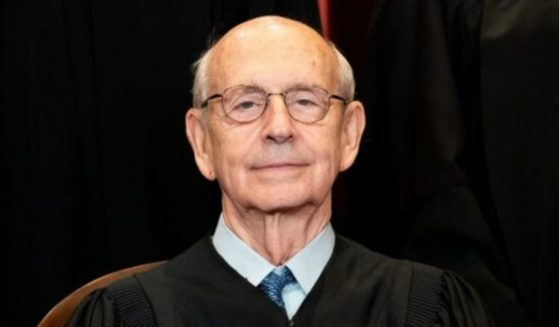 Associate Justice Stephen Breyer sits during a group photo of the justices at the Supreme Court in Washington on April 23.