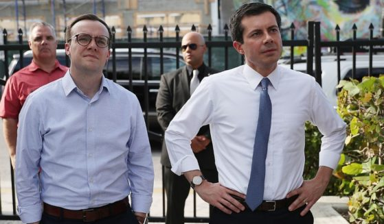 Then-Democratic presidential candidate Pete Buttigieg, right, and his husband, Chasten, wait to be introduced during a fundraiser at the Wynwood Walls in Miami on May 20, 2019.