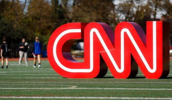 A CNN sign rests on an athletic field outside the Clements Recreation Center before a Democratic presidential primary debate at Otterbein University on Oct. 14, 2019, in Westerville, Ohio.