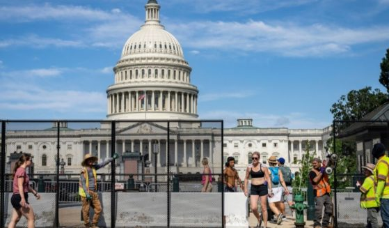 Members of the public exit and enter the Capitol plaza as workers remove security fencing surrounding the U.S. Capitol on July Sunday Washington, D.C.