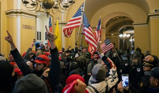 Demonstrators wave American flags during the incursion of the Capitol in Washington on Jan. 6.