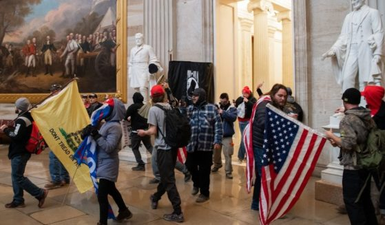 Protesters walk around in the Rotunda during the Capitol incursion on Jan. 6 in Washington.