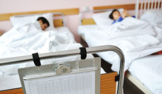 Children are pictured in hospital beds in the stock image above.