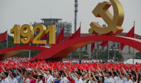 Members of the audience stand and applaud Chinese President and Chairman of the Communist Party Xi Jinping, not seen, during his speech at a ceremony marking the 100th anniversary of the Communist Party at Tiananmen Square on Thursday in Beijing, China.