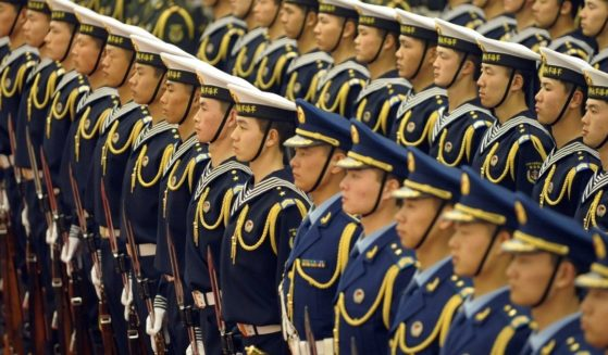 Members of a Chinese People's Liberation Army honour guard line up during a welcome ceremony at the Great Hall of the People in Beijing on Feb. 25, 2010.