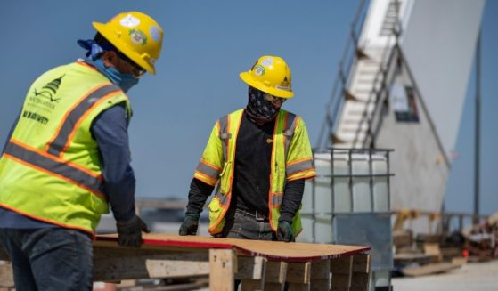 Construction workers work on the new Frederick Douglass Memorial Bridge on May 19, 2021, in Washington, D.C.