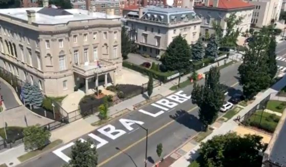 """The words """"Cuba Libre"""" are seen in the street in front of the Cuban embassy in Washington."""