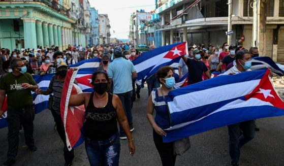 People take part in a demonstration in Havana on Sunday.