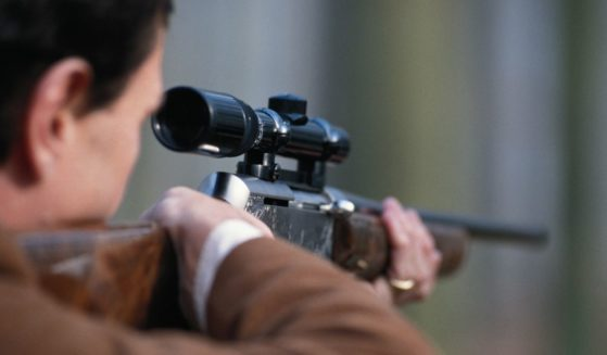 This stock image portrays a man aiming a rifle. The upper house of the Czech parliament has approved the right for citizens to bear arms in the constitution.