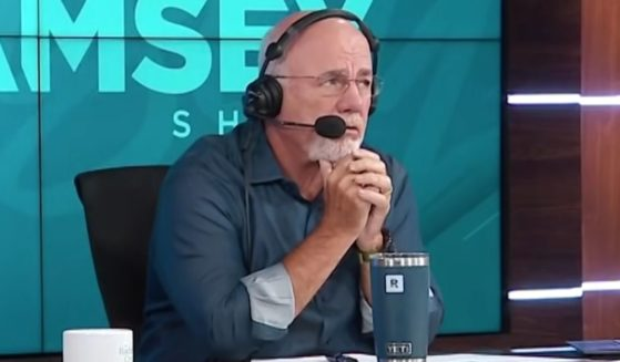 Personal finance expert and radio show host Dave Ramsey listens as a caller from Tampa, Florida, describes her financial difficulties.