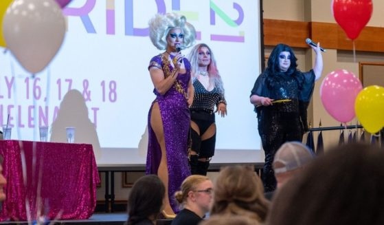 Pictures from the event include a shot of a child holding a 'Love Knows No Gender' sign and the featured drag performers at the event.