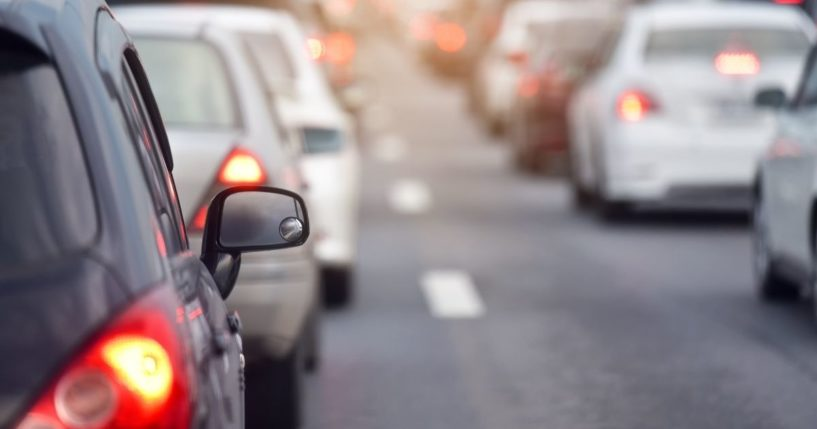 This stock photo portrays cars driving on a busy road. The FBI is reportedly now using built-in WiFi hotspots in cars to track people.