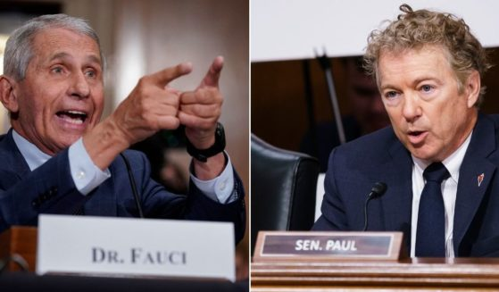 Dr. Anthony Fauci, left, responds to accusations by Kentucky Republican Sen. Rand Paul, right, during questioning before the Senate Health, Education, Labor and Pensions Committee on Capitol Hill in Washington on Tuesday