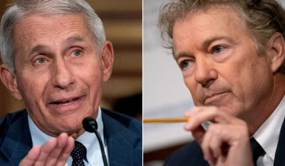 Dr. Anthony Fauci, left, director of the National Institute of Allergy and Infectious Diseases, faced tough questions from Republican Sen. Rand Paul of Kentucky, right, during a Senate Health, Education, Labor, and Pensions Committee hearing on Capitol Hill in Washington on Tuesday.