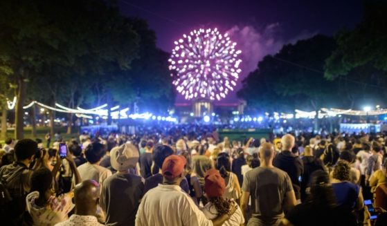 Spectators watch the annual Independence Day fireworks display outside the Philadelphia Museum of Art in Philadelphia on Sunday.