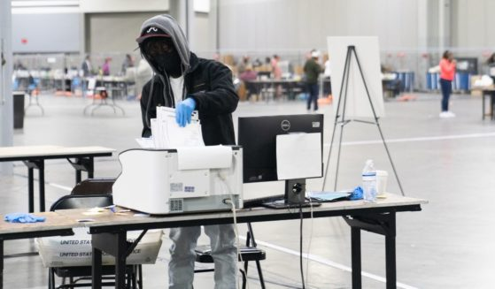 Election officials count votes for Fulton County on Jan. 6, 2021, in Atlanta.