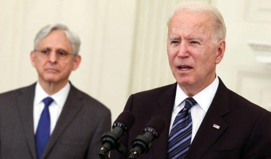 President Joe Biden, joined by Attorney General Merrick Garland, speaks at the White House in Washington on June 23.