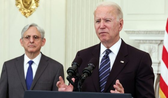 President Joe Biden, joined by Attorney General Merrick Garland, speaks about gun control measures at the White House in Washington on June 23.