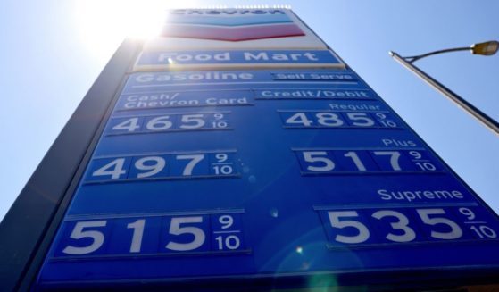 Gas prices are displayed at a Chevron station on June 14, 2021 in Los Angeles, California.