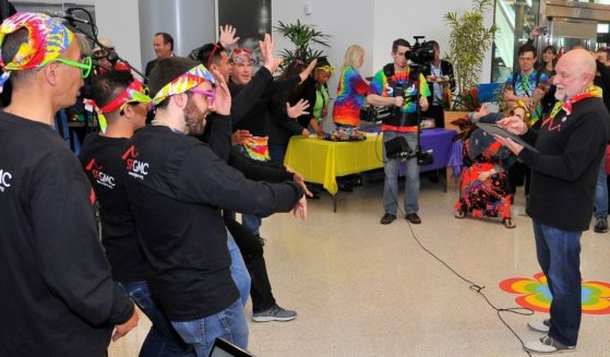 """The San Francisco Gay Men's Chorus performs at the San Francisco International Airport in celebration of the 50th anniversary of the """"Summer of Love"""" on May 13, 2017."""