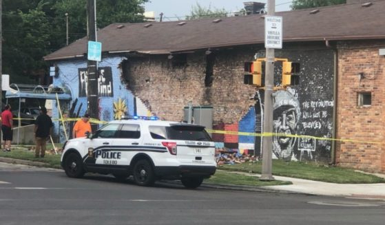 Police corner off a private building in Toledo, Ohio, after a painted mural of George Floyd was reportedly struck by lightning on Tuesday.