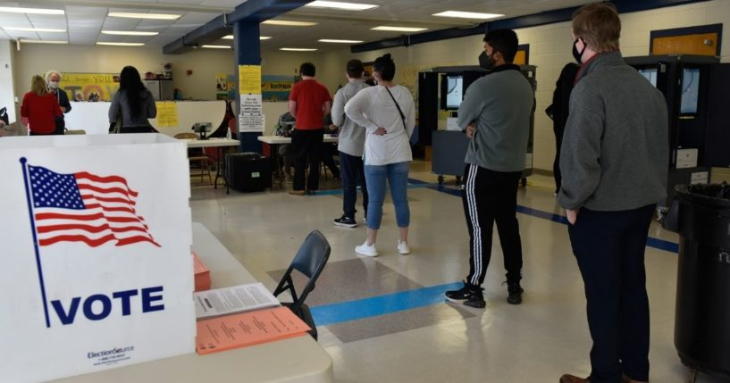 Georgia voters line up at the Sara Smith Elementary School polling station in the Buckhead district of Atlanta during the state's Senate runoff election on Jan. 5.