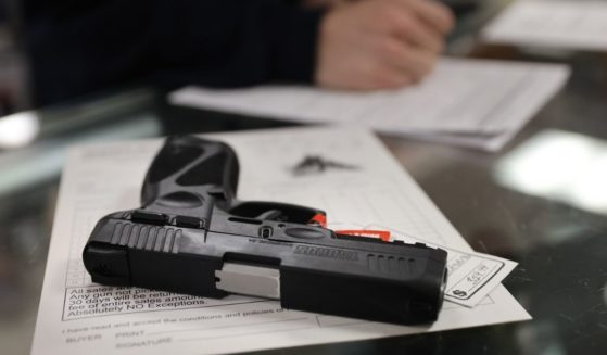 A customer purchases a handgun at Freddie Bear Sports in Tinley Park, Illinois, on April 8.