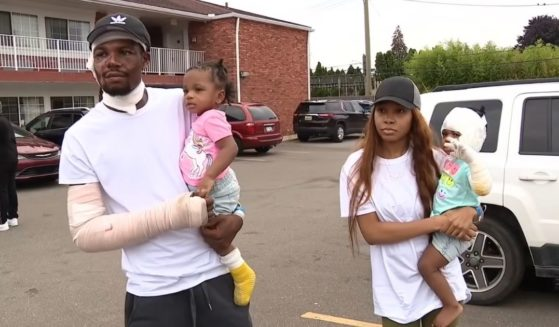 Ray Lucas with his girlfriend, ShiAnn Brown, and their twin daughters, Malaysia and Milan, who were trapped in the basement when the house near Detroit caught fire.