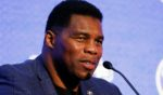 Herschel Walker talks during the NCAA college football Southeastern Conference Media Days on July 16, 2019, in Hoover, Alabama.