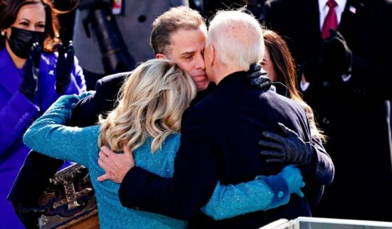 President Joe Biden, right, is comforted by his son Hunter Biden, center, and first lady Jill Biden after being sworn in during the 59th presidential inauguration in Washington, D.C., on the West Front of the U.S. Capitol on Jan. 20, 2021.
