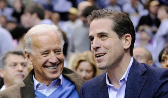 Then Vice President Joe Biden, left, and his son Hunter Biden appear at the Duke Georgetown NCAA college basketball game in Washington on Jan. 30, 2010.