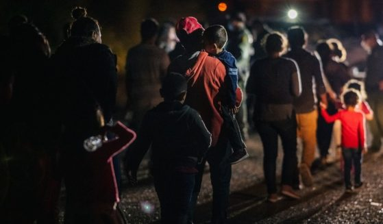 Immigrants seeking asylum walk to be processed and taken to a Border Patrol processing facility after crossing the Rio Grande into the U.S. on June 16, 2021, in Roma, Texas.