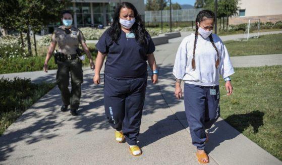 Inmates walk during recess at Las Colinas Women's Detention Facility in Santee, California, on April 22, 2020.