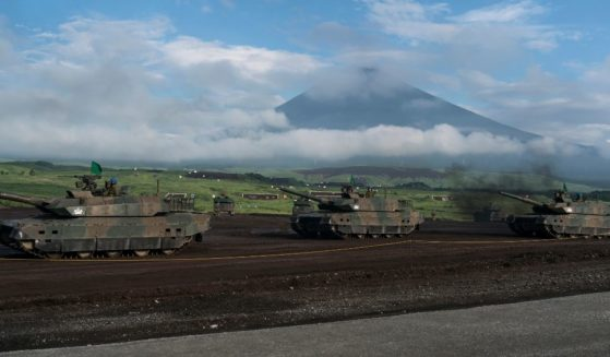 Japan Ground Self-Defense Force battle tanks move during a live fire exercise at the foot of Mount Fuji in the Hataoka district of the East Fuji Maneuver Area in Gotemba, Shizuoka, on Aug. 22, 2019.