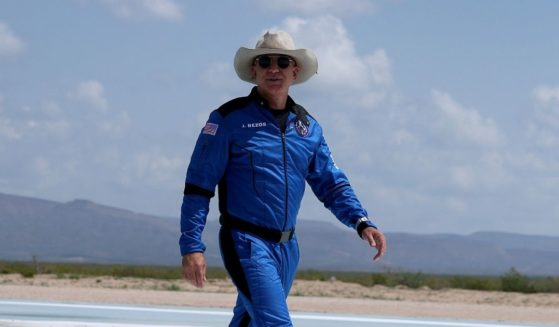 Jeff Bezos walks near Blue Origin's New Shepard after flying into space on Tuesday in Van Horn, Texas.