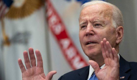 President Joe Biden speaks during a meeting in the Roosevelt Room of the White House in Washington on Thursday.
