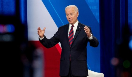Cameras are visible in the foreground as President Joe Biden speaks at a CNN town hall at Mount St. Joseph University in Cincinnati on Wednesday.