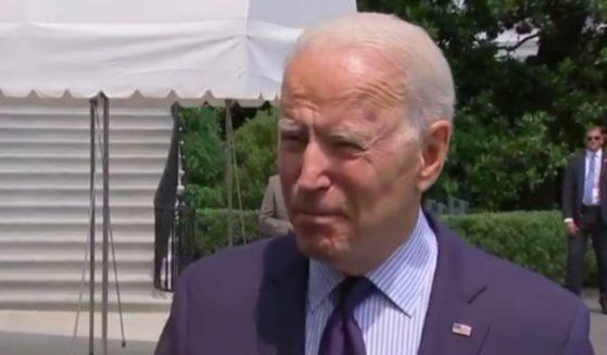 Joe Biden speaks to reporters regarding vaccines