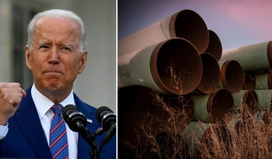 President Joe Biden speaks during Independence Day celebrations on the South Lawn of the White House in Washington, D.C., on July 4, 2021. Unused pipes prepared for the Keystone XL Pipeline are seen on Oct. 14, 2014, outside Gascoyne, North Dakota.