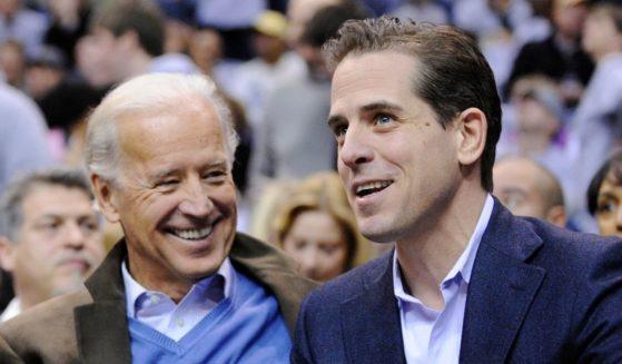 Then-Vice President Joe Biden, left, and his son Hunter Biden appear at the Duke-Georgetown NCAA college basketball game in Washington, D.C., on Jan. 30, 2010.
