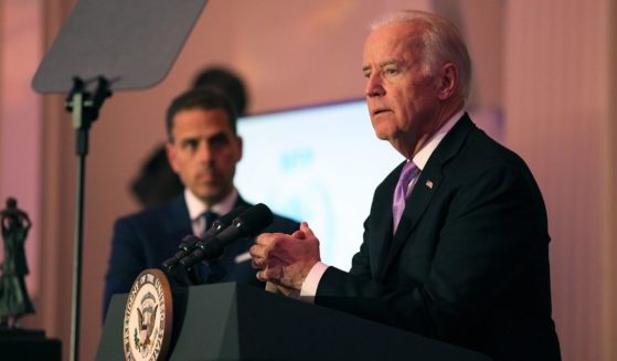 Hunter Biden, left, and then-Vice President Joe Biden speak on stage at the World Food Program USA's Annual McGovern-Dole Leadership Award Ceremony at Organization of American States on April 12, 2016, in Washington, D.C.