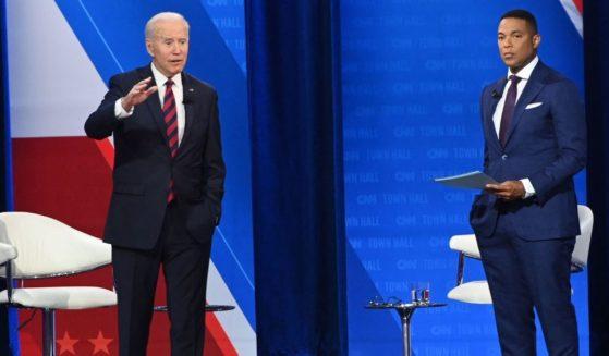 President Joe Biden speaks during a CNN town hall hosted by Don Lemon, right, at Mount St. Joseph University in Cincinnati on Wednesday.