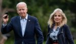 President Joe Biden and first lady Jill Biden walk on the South Lawn upon returning to the White House in Washington, D.C., on Sunday.