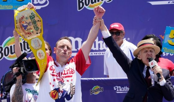 Defending Champion Joey Chestnut wins having consumed 76 hot dogs during the 2021 Nathans Famous Fourth of July International Hot Dog Eating Contest at Coney Island on Sunday in New York City.